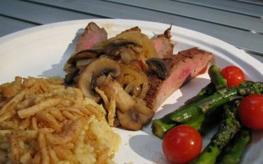 Camping Cuisine – Flank Steak with Caramelized Onions and Mushrooms alongside Asparagus and Tomatoes
