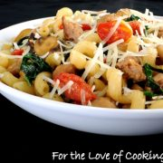 Cavatappi Pasta with Turkey Italian Sausage, Mushrooms, Tomatoes, and Kale