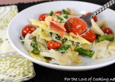 Spinach and Ricotta Ravioli topped with Asparagus and Tomato Sauté with Fresh Crab and Parmesan