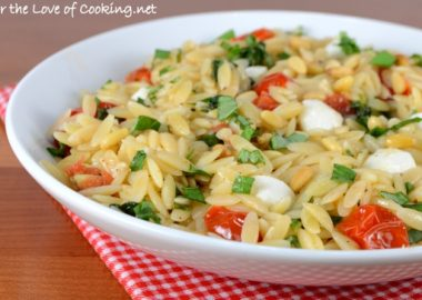 Orzo with Sautéed Garlicky Spinach and Tomatoes topped with Mozzarella and Toasted Pine Nuts
