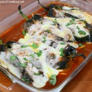 Cheesy Roasted Poblano Peppers with Homemade Refried Beans and Enchilada Sauce