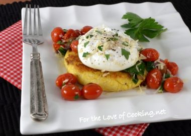 Polenta Cake Topped with Sautéed Tomatoes, Spinach, and a Poached Egg