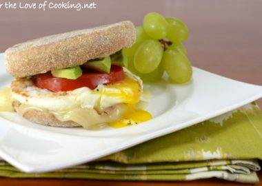 Breakfast Sandwich with Egg, Avocado, Tomato, and Swiss Cheese