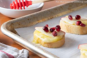 Brie Apple Crostini with Honey and Pomegranate Seeds