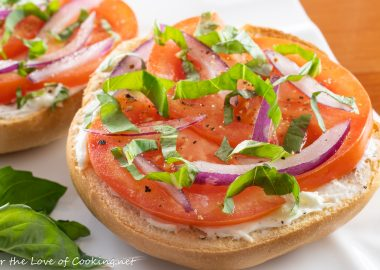 Open Faced Bagel with Cream Cheese, Tomato, Red Onion, and Fresh Basil
