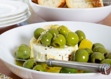 Marinated Olives & Goat Cheese with Garlic Crostini