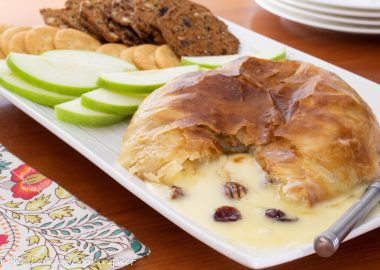 Baked Brie en Croute (with Honey, Candied Pecans and Cranberries)